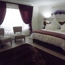 Deluxe room 6, fitted with a king size bed and ensuite bathroom